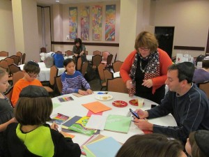 Youth Director Sharon Rappaport and kids make art